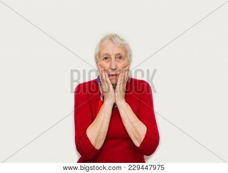 Close-up Of A Senior Woman With Horror Emotions. Old Woman With Surprised Expression On Her Face On