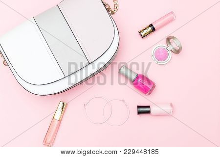 Handbag And Cosmetics For Makeup On A Pink Background. Flat Lay