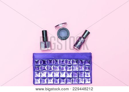 Cosmetic Of Ultraviolet Color And Cosmetics On A Pink Background. Flat Lay