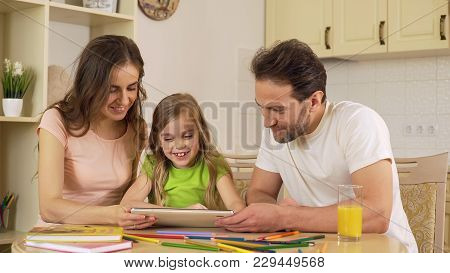 Happy Family Viewing Photos On Tablet, Girl Sliding Pictures On Touchscreen, Stock Footage