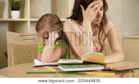 Sad Daughter And Mother Having Conflict Doing Lot Of Hard And Boring Homework, Stock Footage