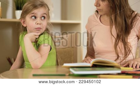 Bored Daughter Surprisedly Looking To Mother Making Her To Do Homework, Stock Footage