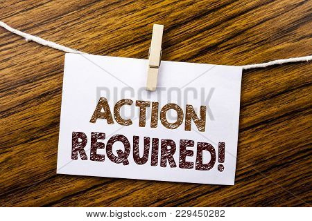 Handwriting Announcement text showing Action Required. Business concept for Immediate Urgent written on sticky note paper on wooden background. poster