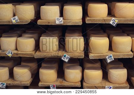 Cheese Aging Factory Cellar With Wooden Schelves