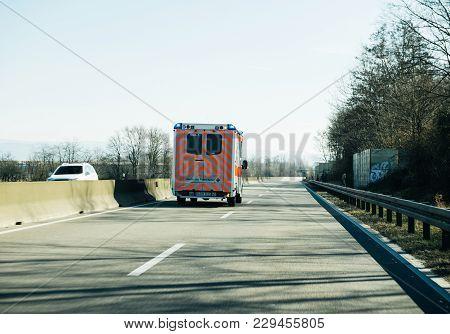 Achern Germany - Feb 18, 2018: Driving In Front Deutsches Rotes Kreuz Ambulance On German Rural Road