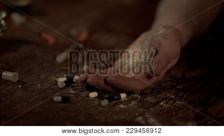 Hand Of Drug Addict And Pills On Floor, Junkie Unconscious After Drug Overdose, Stock Footage