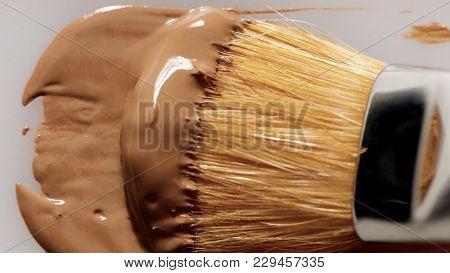 Liquid Foundation Texture Smudge With Brush. Makeup Base Closeup Texture