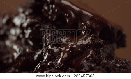 Macro Clip Of Chocolate Desert Texture And A Little Fork Take Away A Part Of It. Studio Macro Shoot
