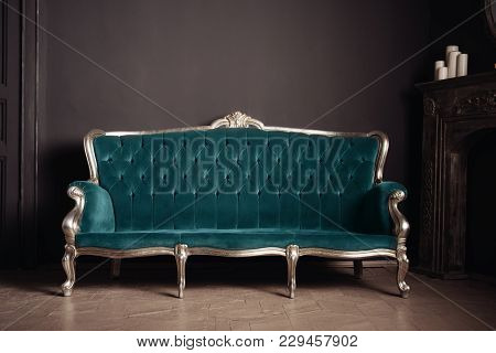 Luxurious Antique Velor Sofa Turquoise Color Near The Fireplace