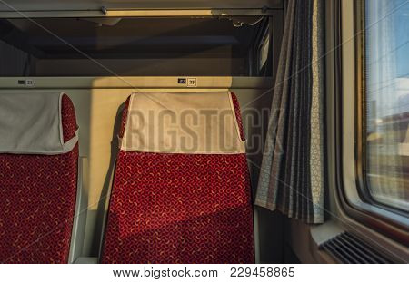 Red Chair In Czech Fast Train In Sunrise Sunny Time
