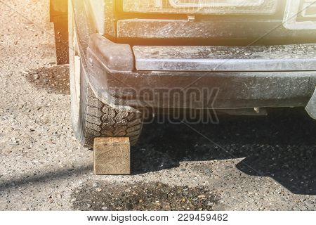 Wooden Fence Under The Wheel For The Machine. Wheel Stop
