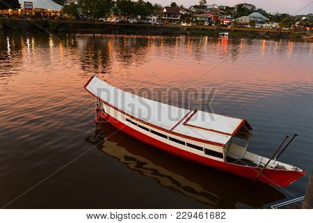 Traditional Wooden Boat On The Sarawak River, Kuching, Malaysia