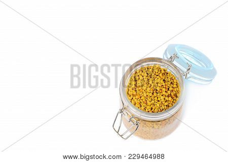 Flower Pollen In A Glass Jar Is Isolated On A White Background. Natural Remedy For Immunity Enhancem