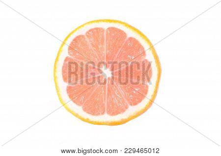 One Half Of A Ripe Lemon With A Pink Flesh Is Isolated On A White Background.