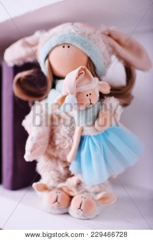 Beautiful Handmade Doll In A Lamb Suit With A Small Doll In Her Hands.