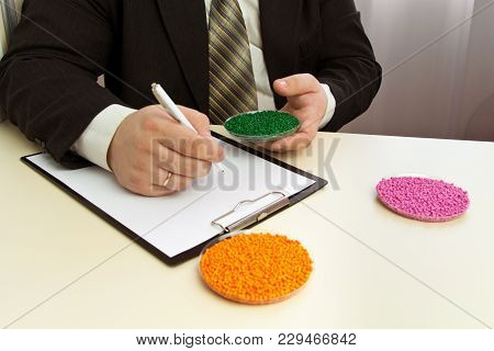 Businessman Signs A Contract For The Supply Of Plastic Granules For Industry. Plastic Raw Material I