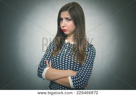 Sad Offended Woman Portrait Isolated On Gray Background. Vexation. Disappointed Girl.