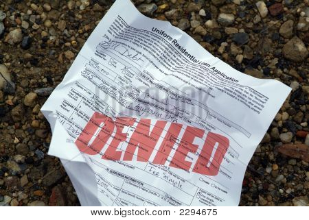 Crumpled Rejected Loan Application