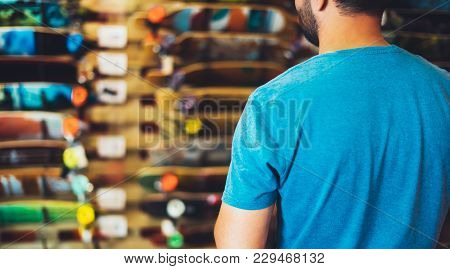 Assortment Skateboard Isolated In Store Shop, Person Choosing And Buy Color Skates On Backgraund Sun