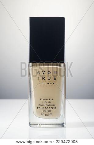 Kwidzyn, Poland - March 1, 2018: Avon Flawless Liquid Foundation Isolated On Gradient Background. Av