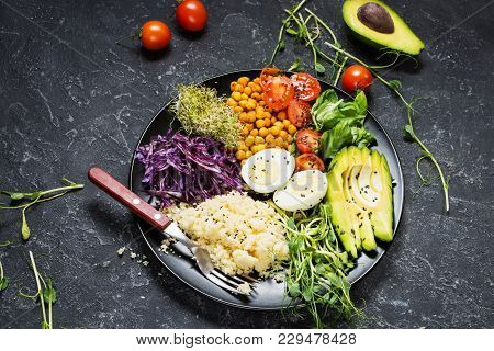 Healthy Vegan Lunch Bowl. Vegan Buddha Bowl. Vegetables And Nuts In Buddha Bowl On Black Concrete Ba