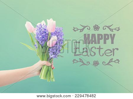 Someones Hand Holding Pink Tulips And Blue Hyacinths Flowers With Happy Easter Greeting