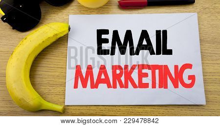Email Marketing. Business Concept For Online Web Promotion Written On Note Empty Paper, Wooden Backg