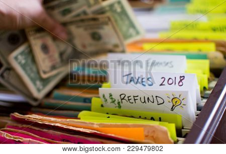 Tax Refund, Doing Taxes Person Holding Money Dollar Bills, With Words Taxes, Tax Refund, 2018, Tax R