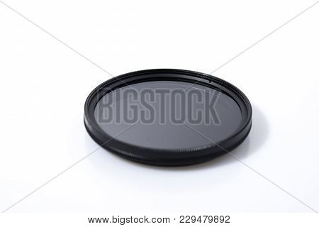 Lens filter reflex polarized filter in a white background composition poster
