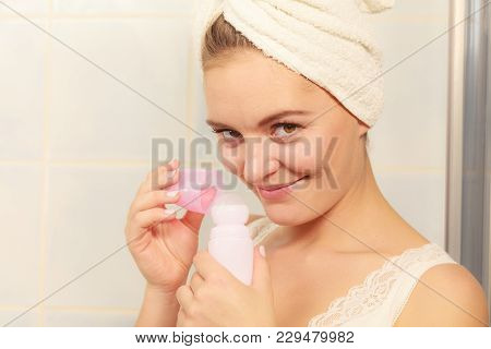 Woman Holding Stick Deodorant In Hands. Girl In Bathroom Towel On Head With Antiperspirant Cosmetics