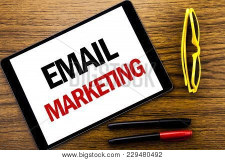 Writing Text Showing Email Marketing. Business Concept For Online Web Promotion Written Tablet Lapto
