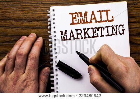 Handwritten Text Showing Word Email Marketing. Business Concept For Online Web Promotion Written Tab