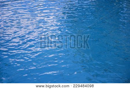 Blue Water Surface Background. Rippled Water Texture. Swimming Pool Surface. Breezy Swimming Pool. F
