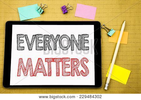 Word, Writing Everyone Matters. Business Concept For Equality Respect Written On Laptop, Wooden Back