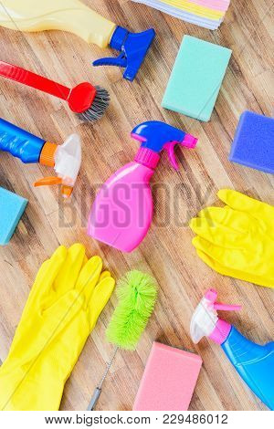 Spring Cleaning Concept - Colorful Sprays Botles And Rubbers Flat Lay Pattern