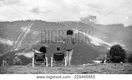 Black And White Silhouettes Of The Group Of Three People On The Bent: Two Girls Are Chilling On Recl