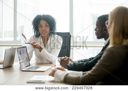 African Businesswoman Showing Good Statistics Report Explaining Deal Advantages Convincing Multiraci