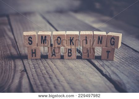 Closeup Of The Words Smoking Habit Formed By Wooden Blocks On A Wooden Floor