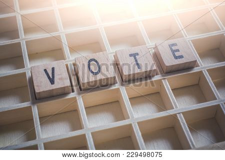 Closeup Of The Word Vote Formed By Wooden Blocks In A Typecase
