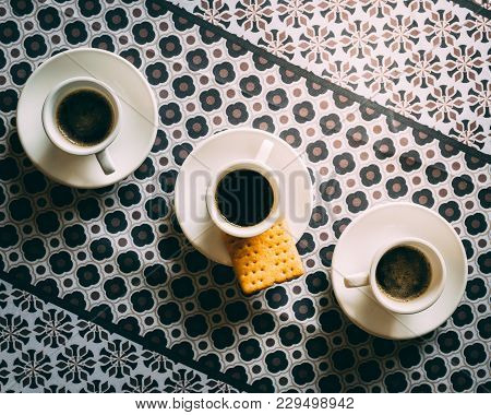 Three Espresso Coffee Cups And Saucers On Pattern Background