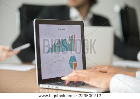 Businesswoman Working With Statistical Report At Team Meeting Analyzing Marketing Result Graphs Char