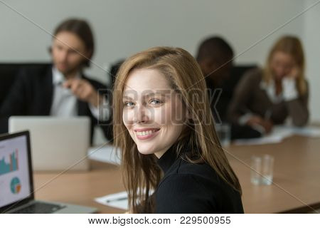 Ambitious Smiling Young Businesswoman At Group Meeting, Happy Executive Manager, Team Leader Or Prof