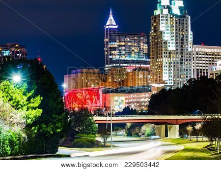 A Beautiful Night Cityscape Of Downtown Raleigh North Carolina With Traffic Trails.