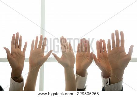 Multi-ethnic Diverse People Hands Lifted Up In The Air, Black And White Palms Raised As Volunteering