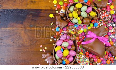 Happy Easter Overhead With Chocolate Easter Eggs And Decorations On A Wood Table Background With Cop