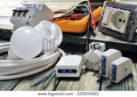 Close Up Of Plugs And Sockets And Other Components For Residential Electrical Installation On Rustic