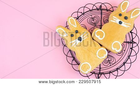 Happy Easter Overhead With Easter Bunny Cookies And Decorations On A Wood Table Background And Copy