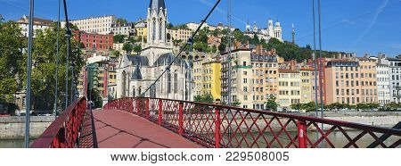 View Of Lyon City From Red Footbridge On Saone River And Church