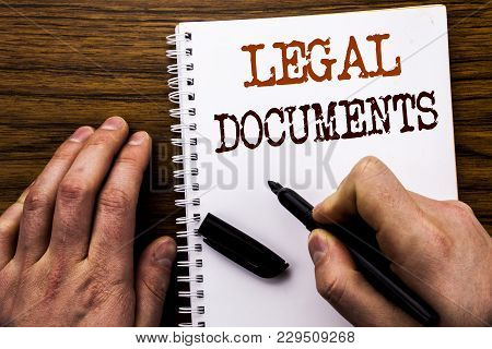 Handwritten Text Showing Word Legal Documents. Business Concept For Contract Document Written Tablet