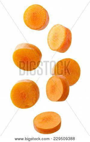 Isolated Falling Vegetables. Falling Sliced Carrot Isolated On White Background With Clipping Path A